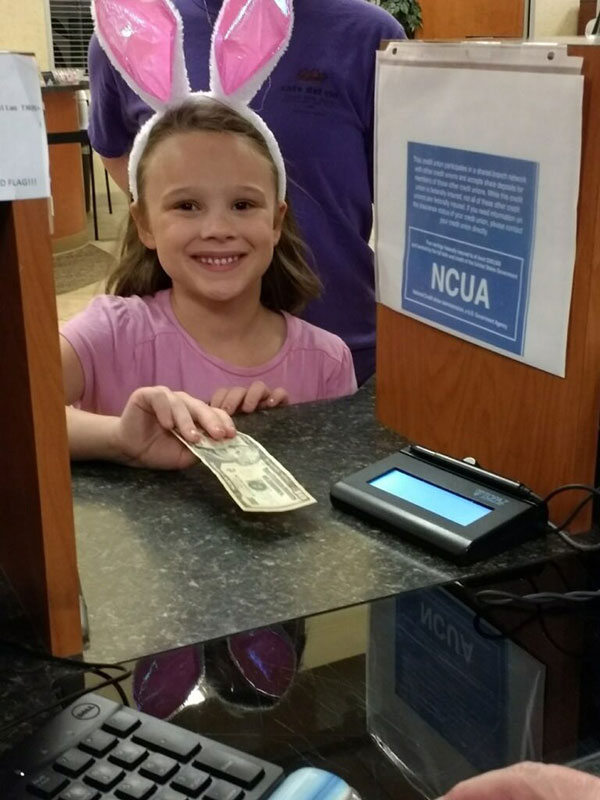 Brooklyn happily handing her savings over to a teller