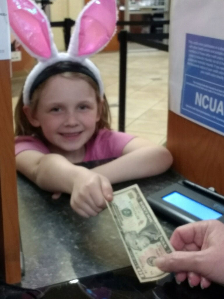 Kynleigh making a deposit at the teller window